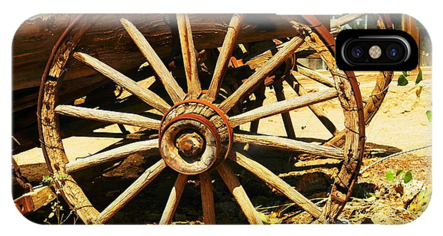 Rounds IPhone X Case featuring the photograph A Wagon Wheel by Jeff Swan