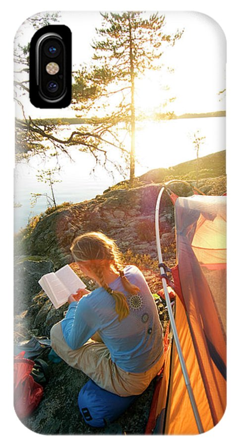 Backlit IPhone X Case featuring the photograph A Woman Is Resting In A Tent On One by Lars Schneider