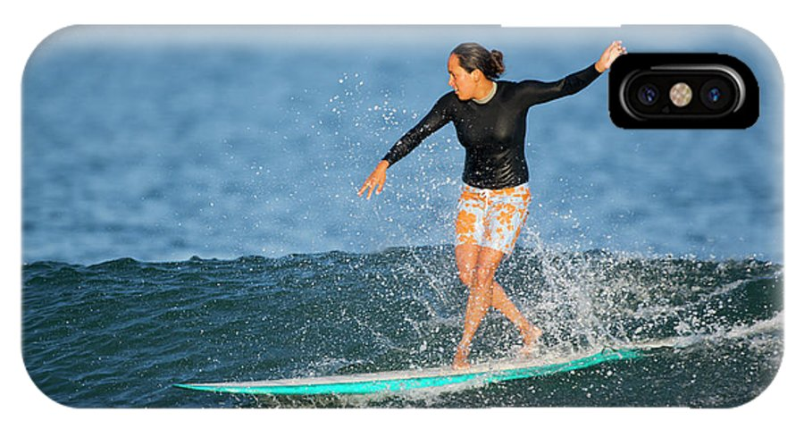 20-25 Years IPhone X Case featuring the photograph A Woman Rides A Wave On A Longboard by Ty Milford
