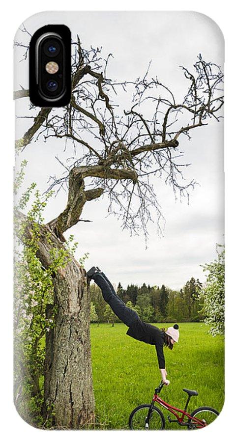 Bmx Flatland IPhone X Case featuring the photograph Amazing Stretching Exercise - Bmx Flatland Rider Monika Hinz Uses A Tree by Matthias Hauser