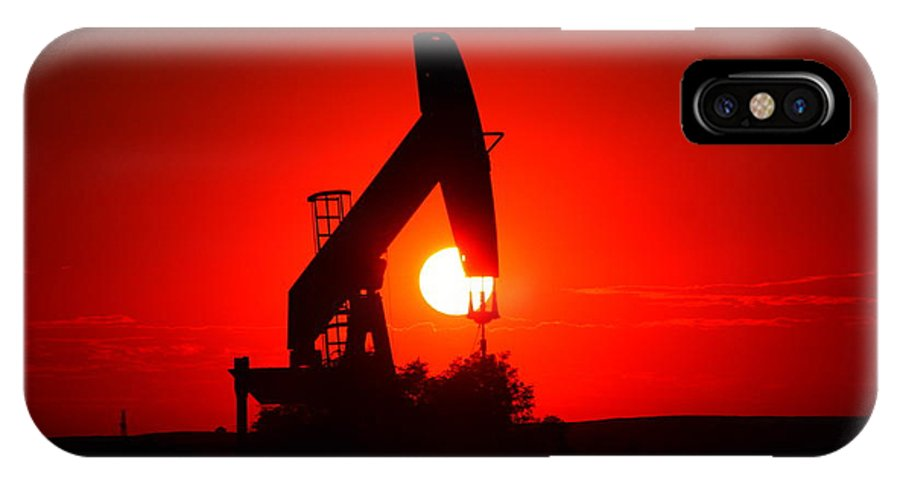 Sunset IPhone X Case featuring the photograph American Oil by Jeff Swan