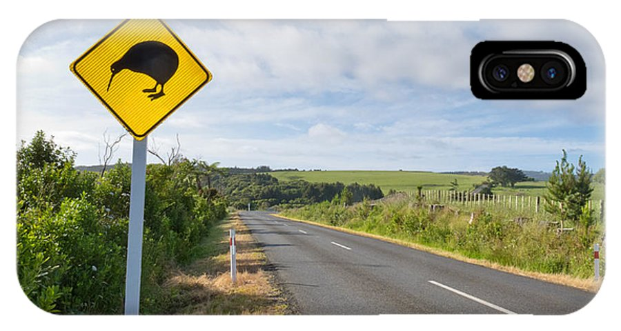 Animal IPhone X Case featuring the photograph Attention Kiwi Crossing Roadsign At Nz Rural Road by Stephan Pietzko