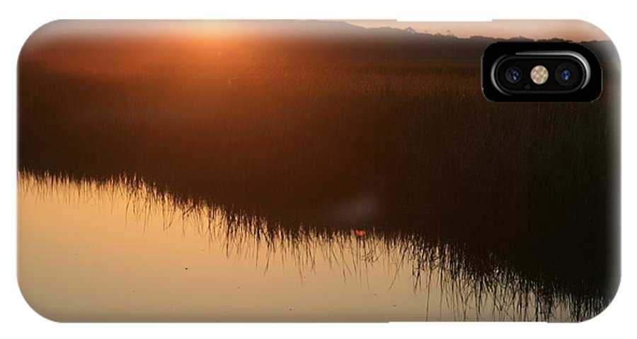 Sunrise IPhone X Case featuring the photograph Autumn Sunrise Over The Marsh by Nadine Rippelmeyer