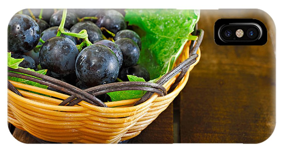 Grape IPhone X Case featuring the photograph Basket Of Grapes On Rustic Wooden Table by Ken Biggs