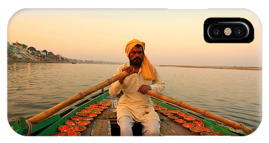 Hindu Pilgrim IPhone X Case featuring the photograph Boat Man On The Ganges River At Varanasi by Amanda Stadther