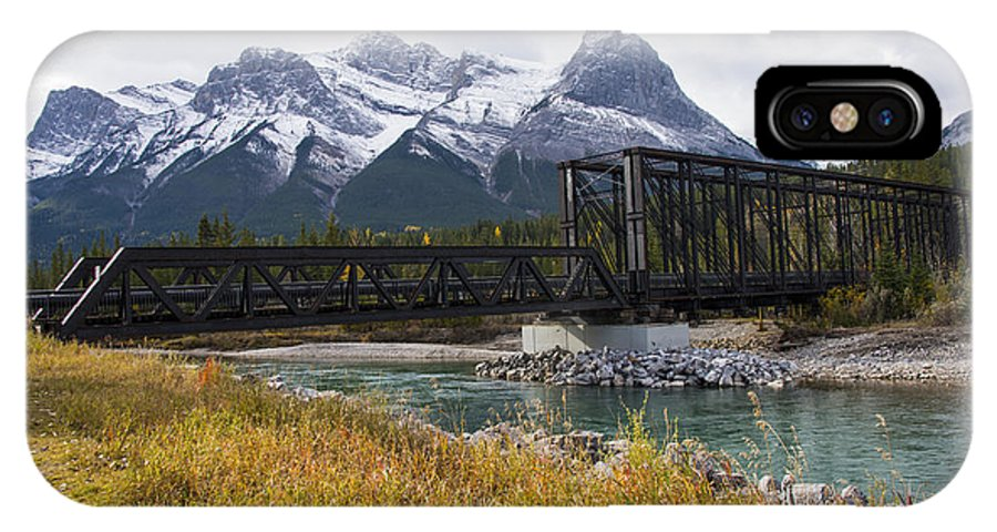Canmore Canada Iron Bridge Railroad Bridges Trestle Trestles Mountain Rocky Mountains Cloud Clouds Grass Grasses Bow River Rivers Canadian Rockies Snow Peak Peaks Rock Rocks Stone Stones IPhone X Case featuring the photograph Bow River Railroad Trestle by Bob Phillips