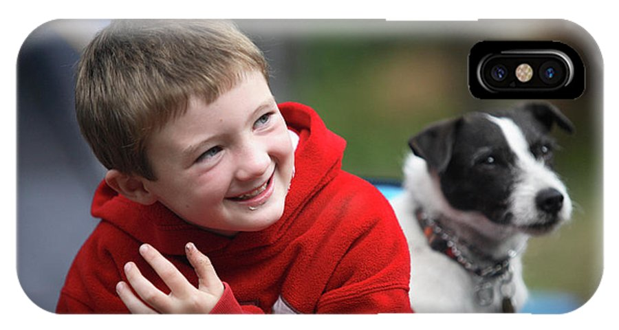 Boy IPhone X Case featuring the photograph Boy, Age 6, Smiling With Jack Russell by Chris Butler