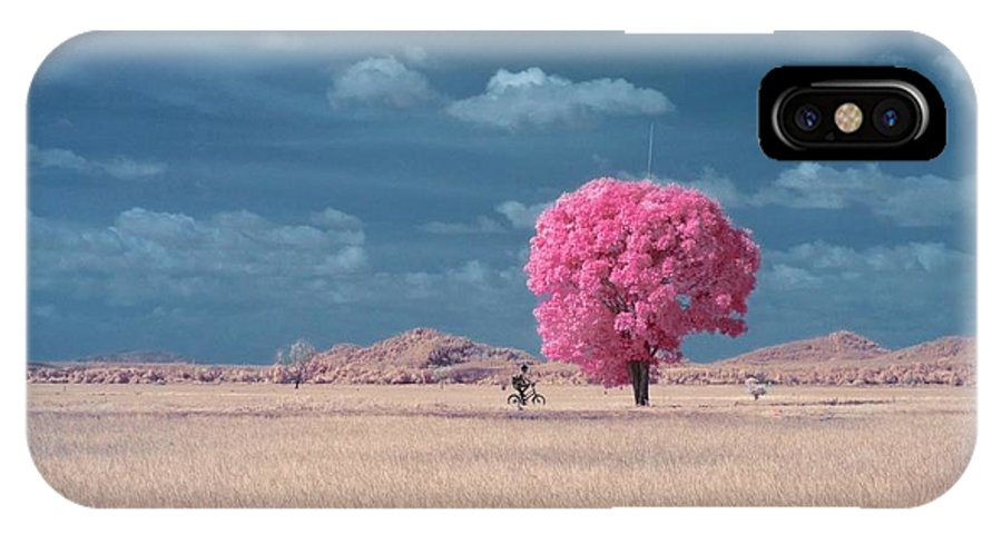 Tranquility IPhone X Case featuring the photograph Boy Riding Bicycle On Country Road by Azrul Yusuf / Eyeem