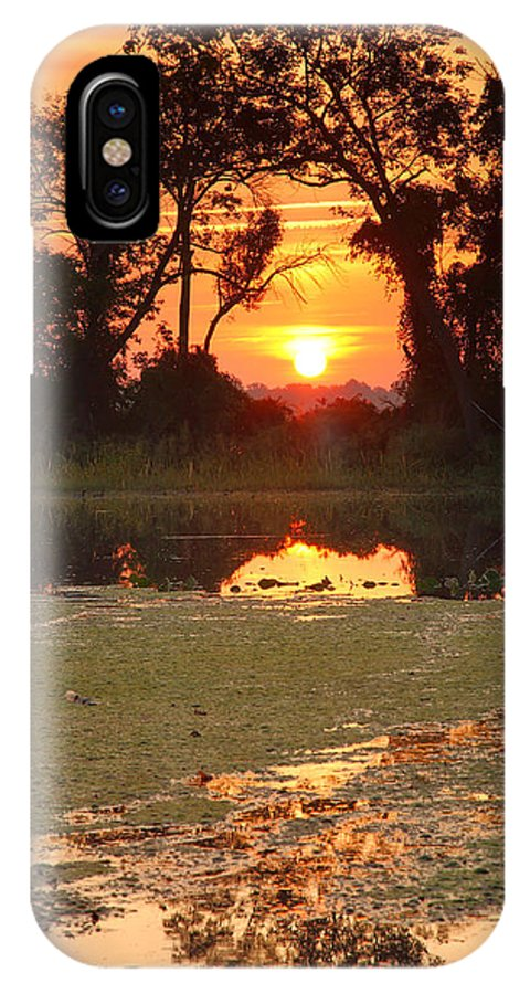 Sunrise IPhone X Case featuring the photograph Breaking Out by Steven Ainsworth