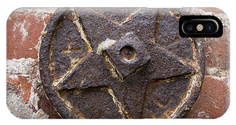 IPhone X Case featuring the photograph Bronze Star Attached To Brick by Jason O Watson