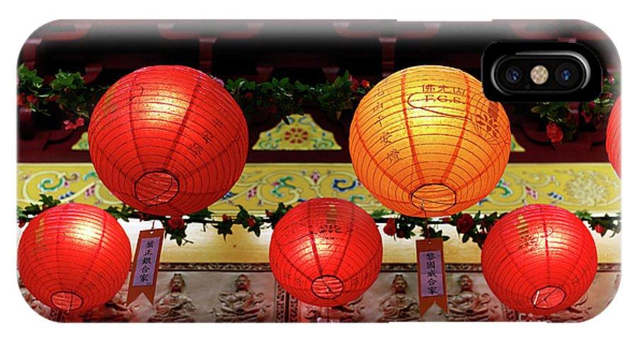 Buddha Lanterns IPhone X Case featuring the photograph Buddha Lanterns by John Rizzuto