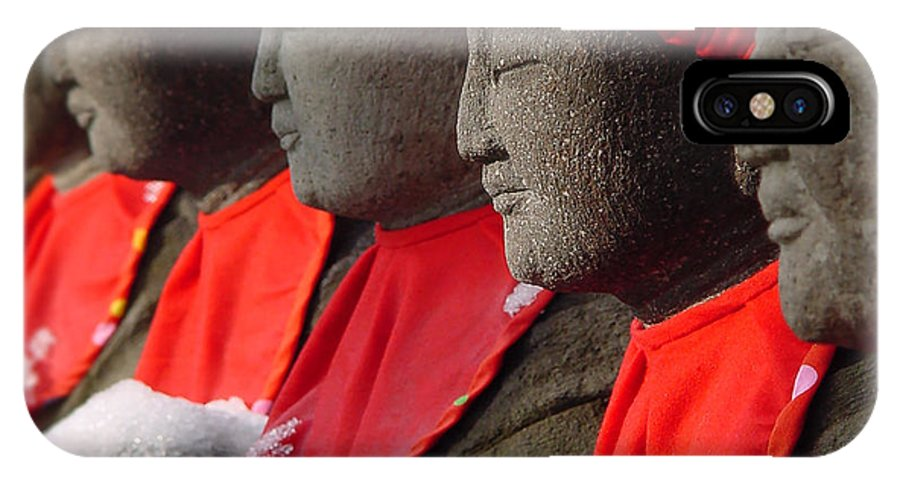Buddhist IPhone X Case featuring the photograph Buddhist Statues In Snow by Larry Knipfing