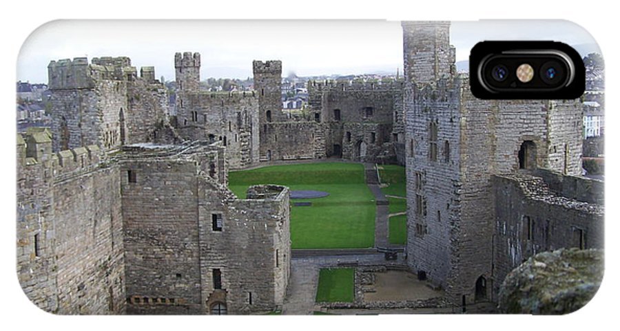 Castles IPhone X / XS Case featuring the photograph Caernarfon Castle by Christopher Rowlands