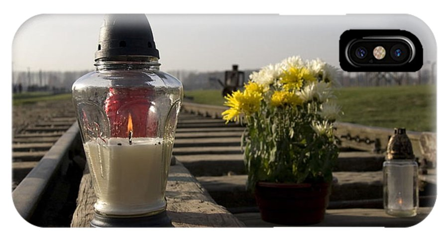 Candle IPhone X Case featuring the photograph Candle Lit In Memory Of The Victims Of Auschwitz Birkenau Poland by Ronald Jansen