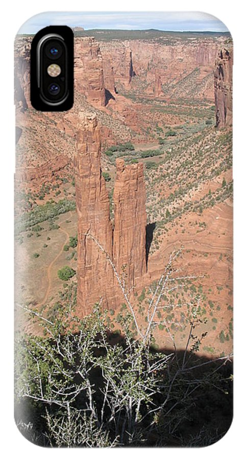 Canyon IPhone X Case featuring the photograph Canyon De Chelly Spider Rock by Christiane Schulze Art And Photography