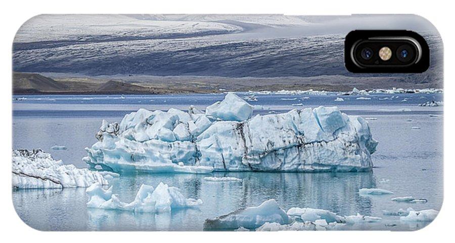 Jokulsarlon IPhone X Case featuring the photograph Chasing Ice by Evelina Kremsdorf