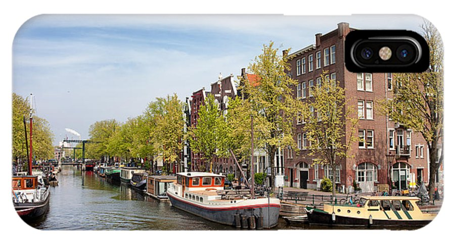 Amsterdam IPhone X Case featuring the photograph City Of Amsterdam In The Netherlands by Artur Bogacki