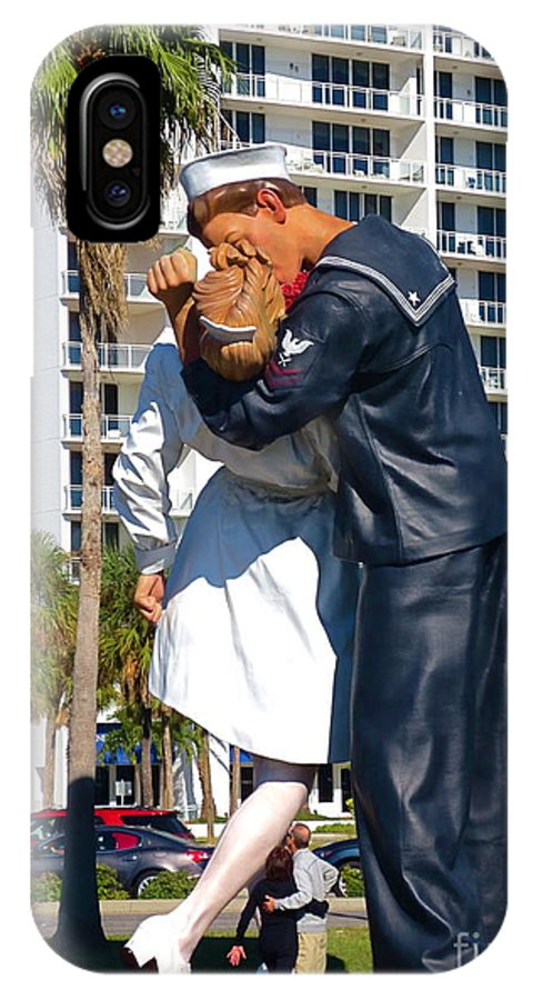 Couple Looking Up To The Famous Wwll Kiss Statue In Sarasota. IPhone X / XS Case featuring the photograph Couple Looking Up To The Famous Wwll Kiss Statue In Sarasota. by Robert Birkenes