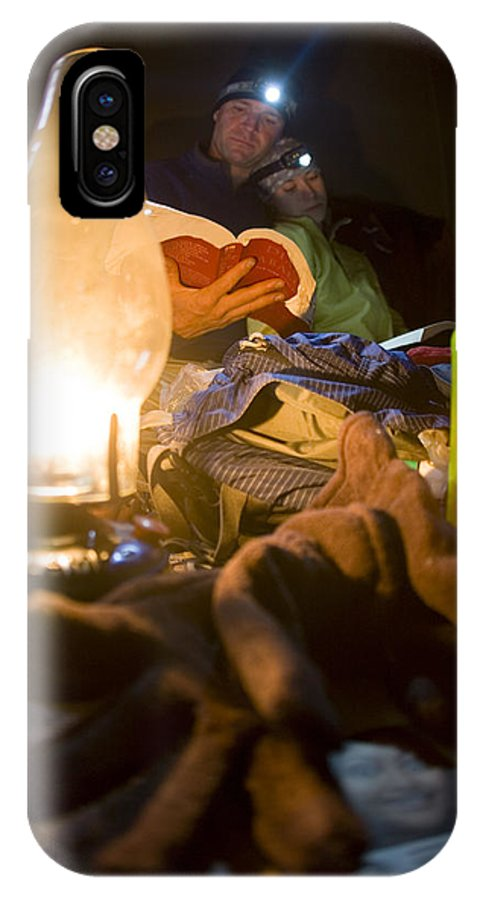 Adventure IPhone X Case featuring the photograph Couple Reading By Lantern, India by Gabe Rogel