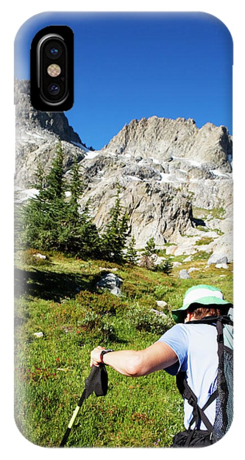 Active IPhone X Case featuring the photograph Cropped Rear View Of A Female Hiker by Ron Koeberer