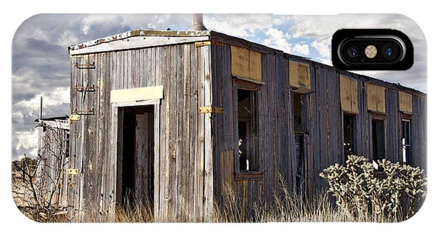 Weathered Exterior IPhone X Case featuring the photograph Cuervo New Mexico by Lee Craig