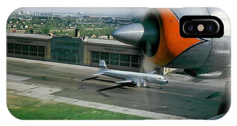 Douglas Dc-7 IPhone X Case featuring the photograph Douglas Dc-7 Taking Off by Wernher Krutein