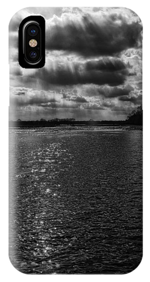 Storm IPhone X Case featuring the photograph Dynamic Storm Over The Marsh by Thomas Young