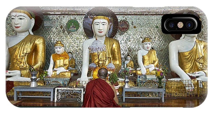 Myanmar IPhone X Case featuring the photograph faithful Buddhist monk praying at Buddha Statues in SHWEDAGON PAGODA by Juergen Ritterbach