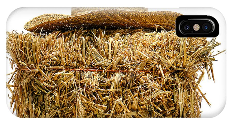 Bale IPhone X Case featuring the photograph Farmer Hat On Hay Bale by Olivier Le Queinec