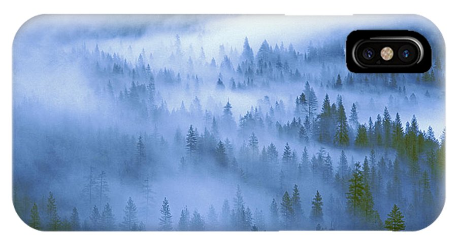 North America IPhone X Case featuring the photograph Fir Trees Shrouded In Fog In Yosemite Valley by Dave Welling