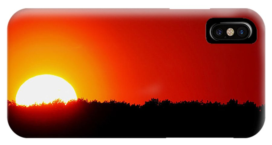Sunset IPhone X Case featuring the photograph Fire In The Sky by Debbie Oppermann