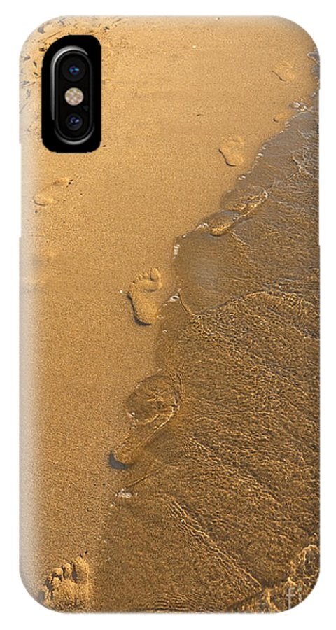 Marbella Is A City In Andalusia IPhone X Case featuring the photograph Footprints In The Sand by Brenda Kean