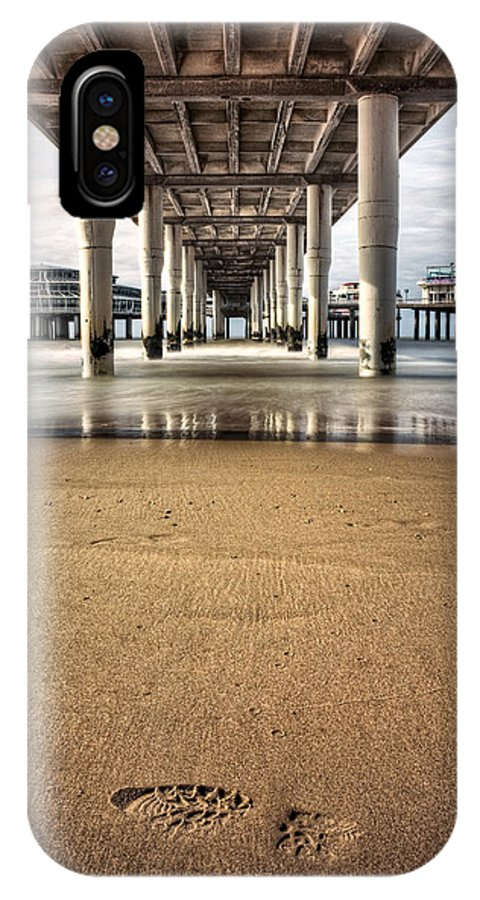 Piers IPhone X Case featuring the photograph Footprints In The Sand by Dave Bowman