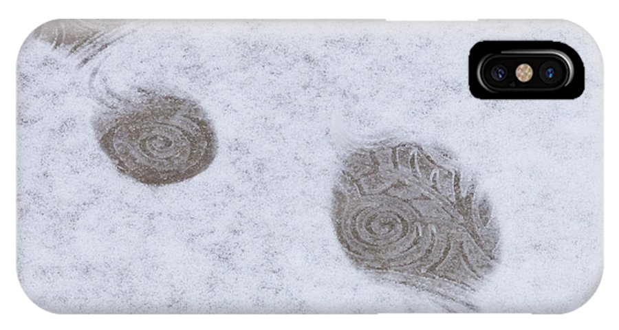 Footprint IPhone X Case featuring the photograph Footprints In The Snow by Diane Macdonald