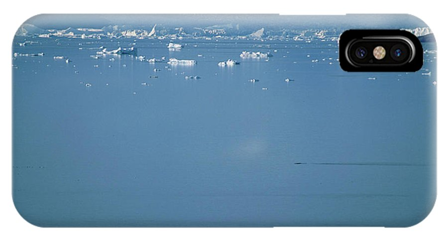 Adventure IPhone X Case featuring the photograph Giant Icebergs Drift In Open Water by David McLain