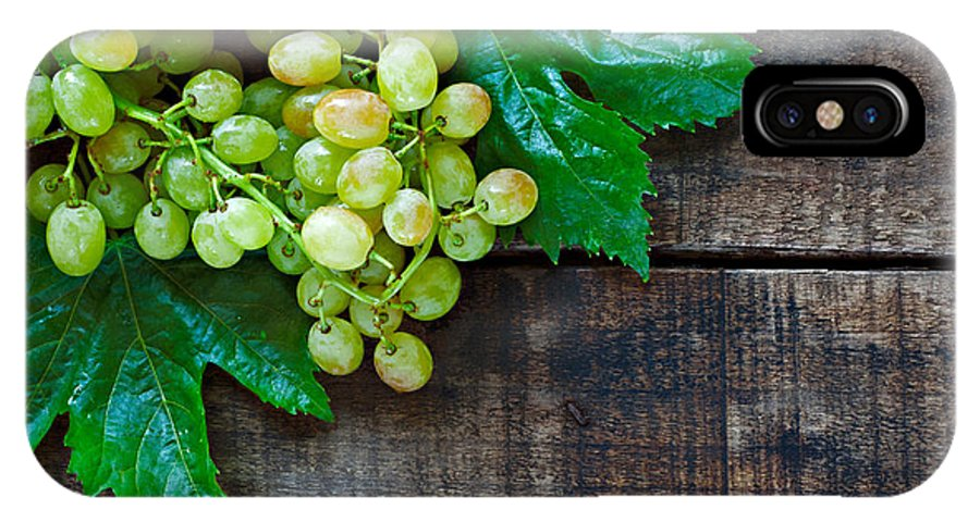Grape IPhone X Case featuring the photograph Green Grapes On A Rustic Wooden Table by Ken Biggs