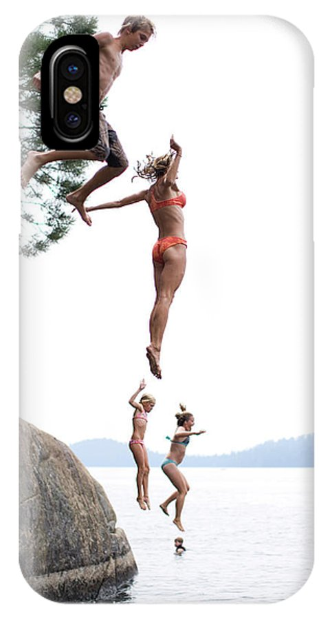 Cliff IPhone X Case featuring the photograph Group Of Family Members Jumping by Woods Wheatcroft