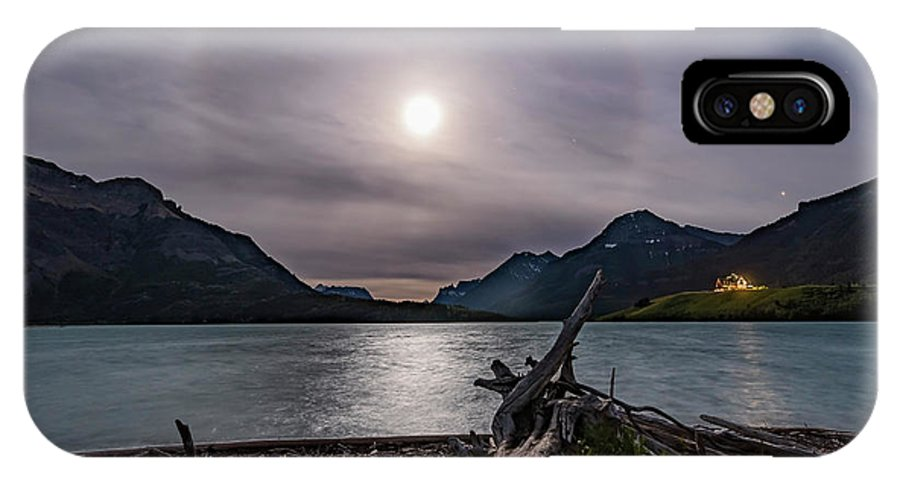 Driftwood Beach IPhone X Case featuring the photograph Halo Around The Solstice Moon by Alan Dyer