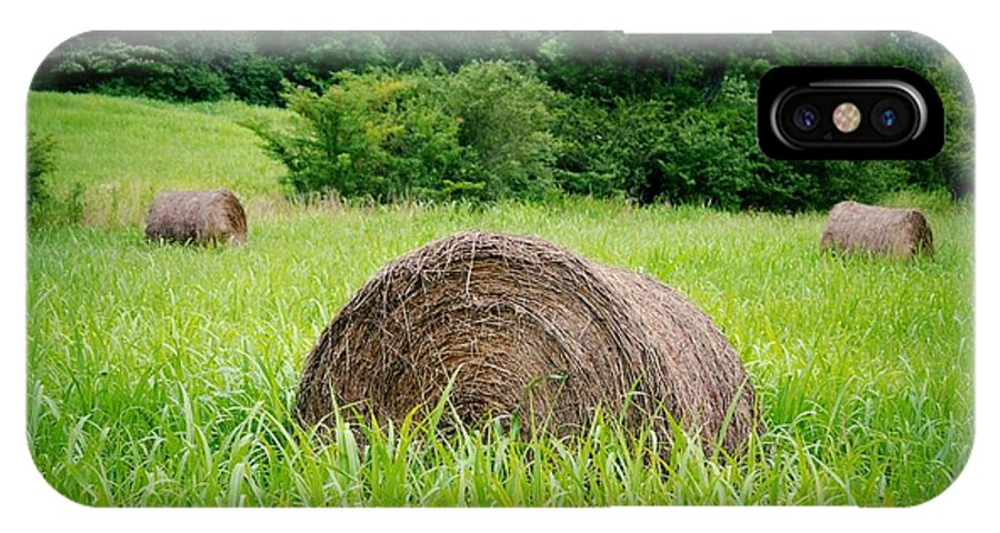 Hayrolls IPhone X Case featuring the photograph Hayroll Field by Tara Potts