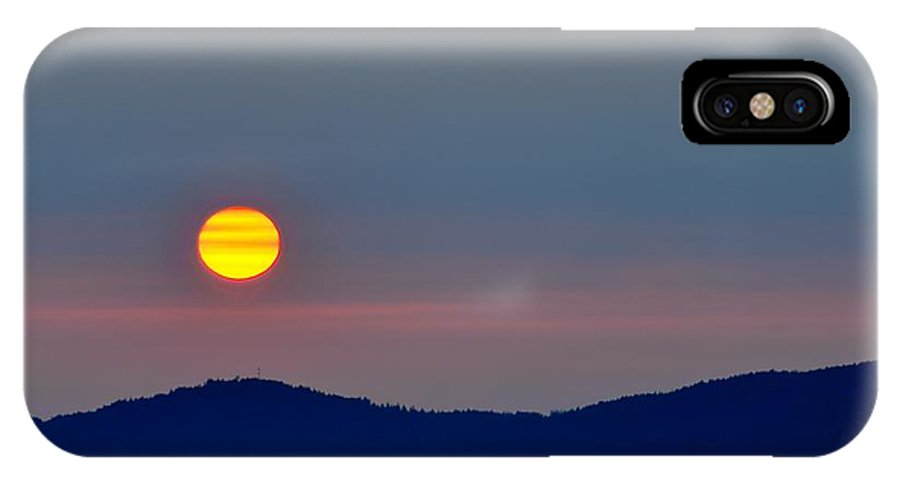 Sunset IPhone X Case featuring the photograph Hazy Sunset by Doug Farmer
