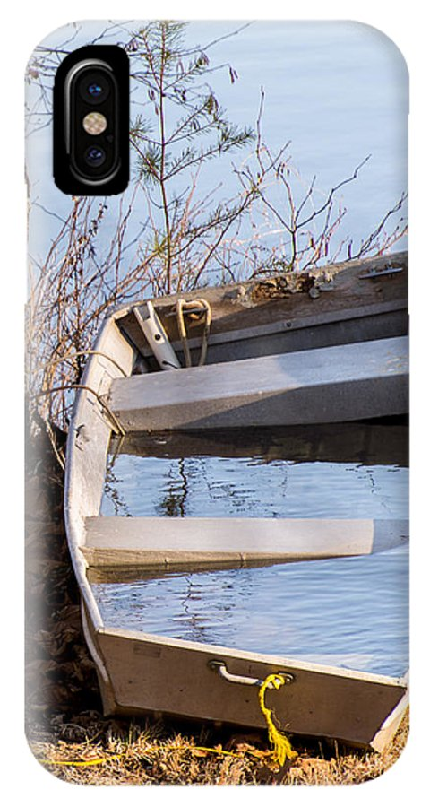 Boat IPhone X Case featuring the photograph I Think The Water Goes Outside The Boat by John Carroll