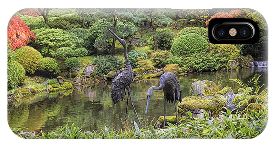 Bronze IPhone X Case featuring the photograph Japanese Bronze Cranes Sculpture By Pond by David Gn