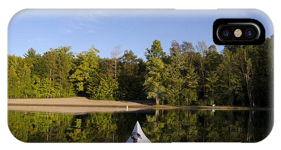 Activity IPhone X Case featuring the photograph Kayak On Calm Lake by Gord Horne