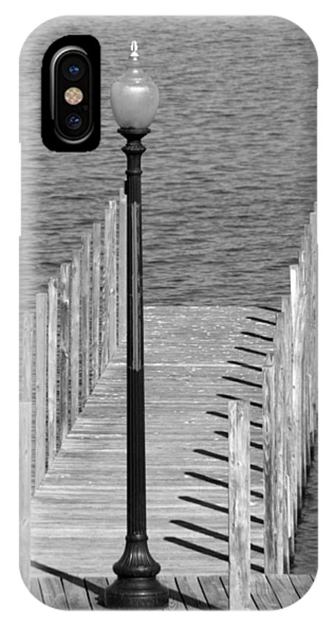 New England IPhone X Case featuring the photograph Lamp And Pier by Caroline Stella