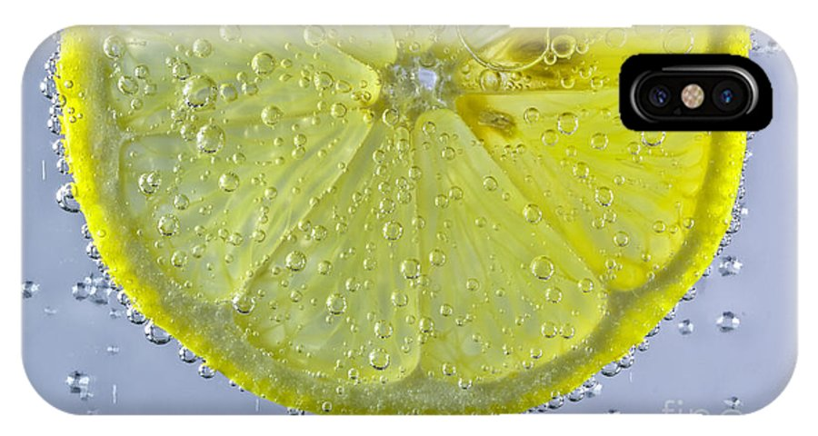 Silhouette IPhone X Case featuring the photograph Lemon Slice In Bubbles by Mitch Johanson