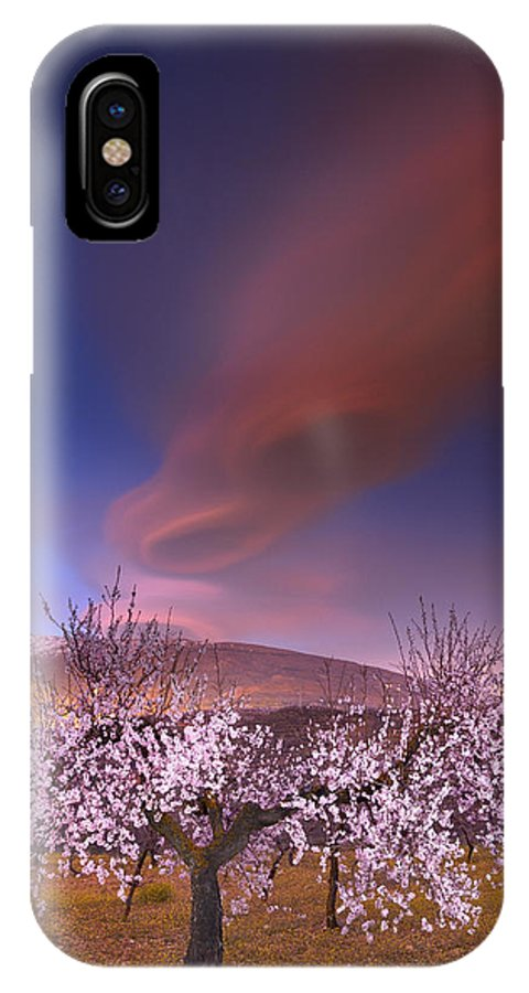 Clouds IPhone X Case featuring the photograph Lenticular Clouds Over Almond Trees by Guido Montanes Castillo