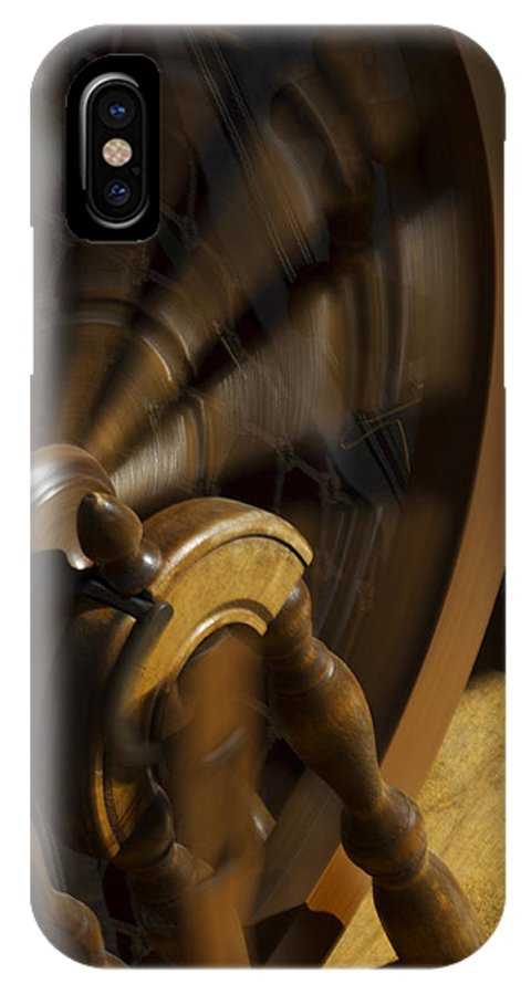 Spinning Wheel IPhone X Case featuring the photograph Let The Spinning Wheel Spin by Guy Shultz