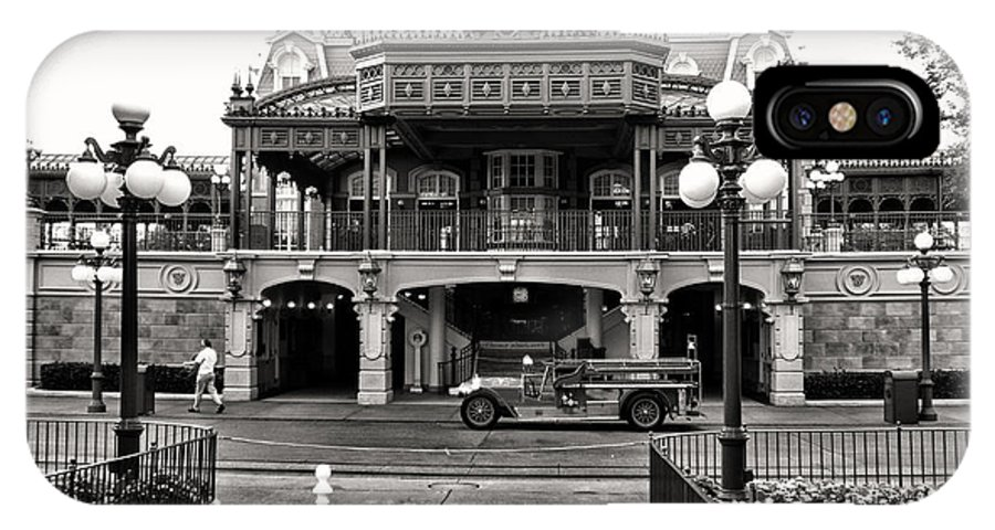 Black And White IPhone X Case featuring the photograph Magic Kingdom Train Station In Black And White Walt Disney World by Thomas Woolworth