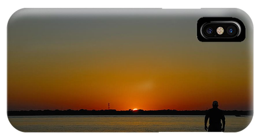 Silhouette IPhone X Case featuring the photograph Man At Sunset. by Charles Beeler