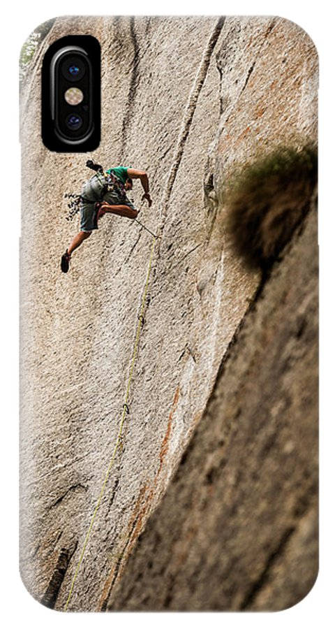Non Urban Scene IPhone X Case featuring the photograph Man Falls While Climbing A Crack Route by Paolo Sartori